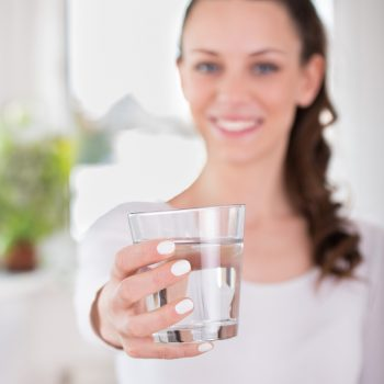 Woman drinking glass of water